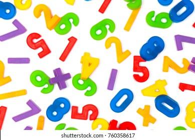 Colorful plastic numbers. Colorful plastic numbers on blank (white) background, randomly arranged. Top view.