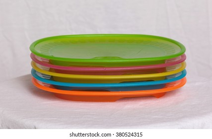 Colorful plastic plates closeup isolated on white background