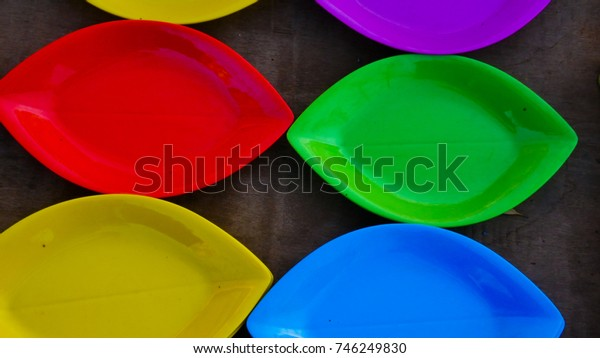 colorful plastic plates for serving food and beverages