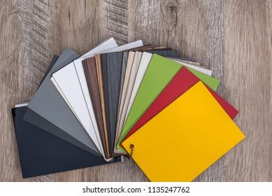 Colorful plastic sampler for furniture on wooden desk