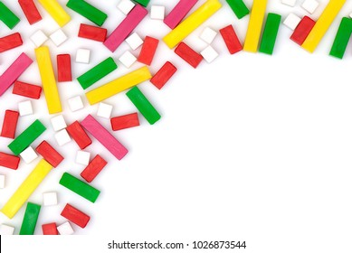 Colorful plastic toy blocks. Colorful plastic toy blocks on a blank (white) background, arranged on top left corner, with copy space. Top view.