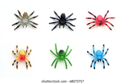 Colorful Plastic Toy Spiders on White Background