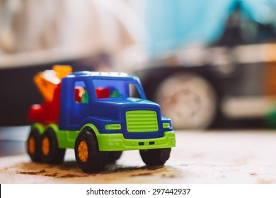 Colorful plastic toy truck on floor home