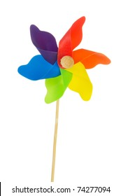 Colorful plastic toy windmill isolated over white background