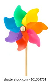 Colorful plastic toy windmill over white