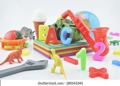 Colorful plastic toys on white background, children education concept