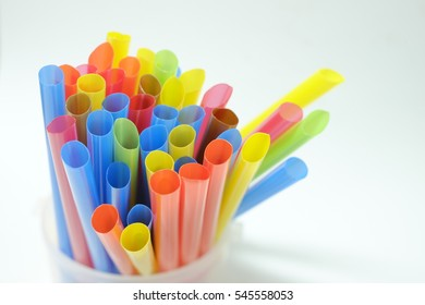 colorful plastic tubes or straws on the white background (isolated) for artwork and party background used