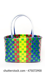 Colorful plastic weave basket isolated on white background