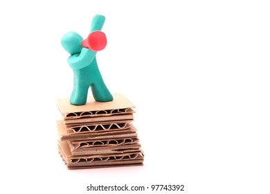 colorful plasticine guy standing on a paper podium with red bullhorn