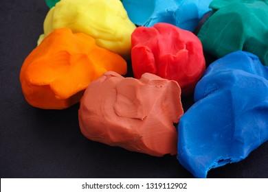 Colorful plasticine pieces. Close up.