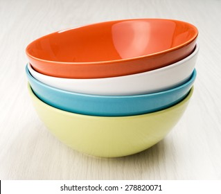 Colorful plates on the dining table light
