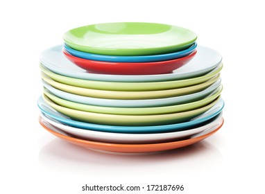 Colorful plates and saucers. Isolated on white background