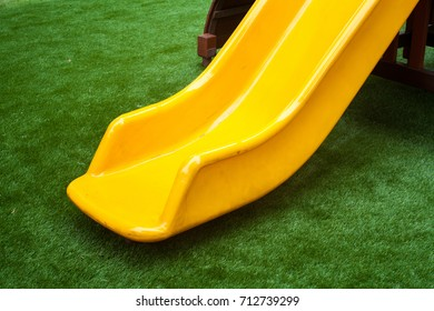 Colorful playground exercise equipment for children in garden.