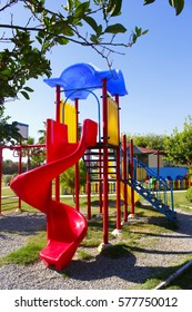 Colorful playground with hill in park