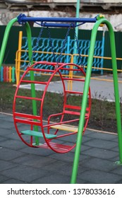 colorful playground in the park ROUND SWING IN CHILDREN'S PARK