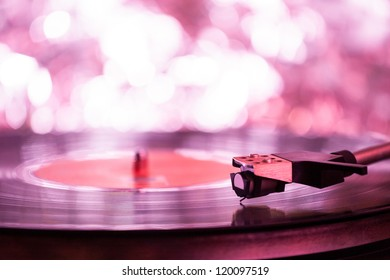 Colorful playing vintage gramophone with blurred blackground