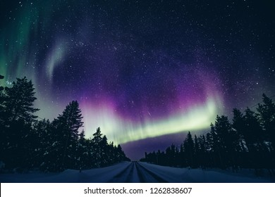 Colorful polar arctic Northern lights Aurora Borealis activity in winter Finland, Lapland