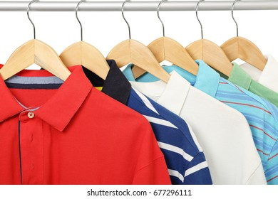 colorful polo shirts on hangers