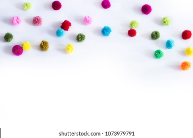 colorful pom poms Crafts on white background. small multicolored fluffy ball for crafts and decoration, Made of yarn.