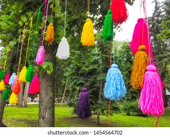 colorful pompons balls many colors , decorative background puffy ethnic style