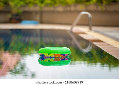 Colorful pool float, ring floating in a refreshing blue swimming pool and surface of blue swimming pool.