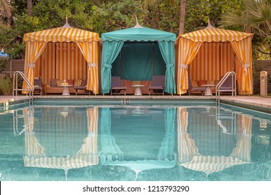 Colorful poolside cabanas
