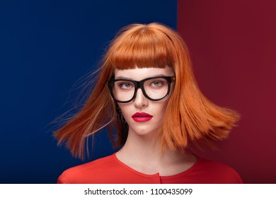 212ea850dccf Colorful portrait of redhead young beautiful woman. Girl wearing fashionable  eyeglasses.