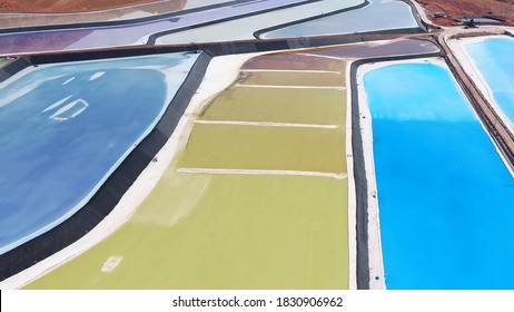 Colorful potash holding ponds in a mining complex.