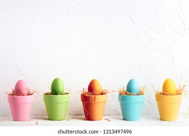 Colorful pots with easter eggs