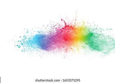 Colorful powder explosion on white background.Pastel color dust particle splashing. Holi festival.