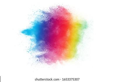 Colorful powder explosion on white background.Pastel color dust particle splashing. Holi festival.