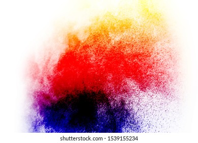 Colorful powder/particles fly after being exploded against white background