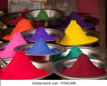 Colorful powders used for dyeing at a market in Orchha, India