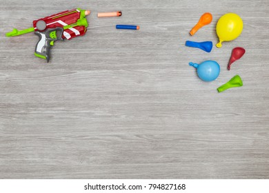 Colorful prank materials on a wooden background, topview with copy space