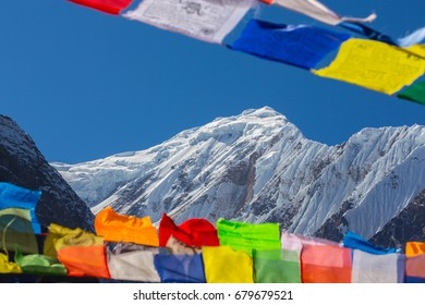 Colorful prayer flags blowing in the wind in Himalaya