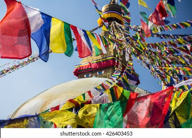 Colorful prayer flags on top of Boudhanath stupa in Nepal.