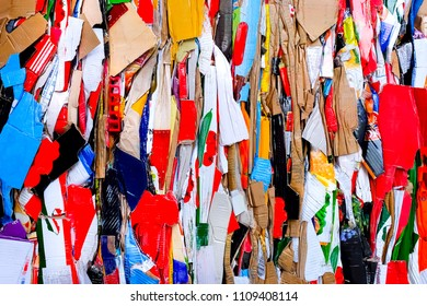 colorful pressed paper waste - in red, blue, yellow, green, natural colors