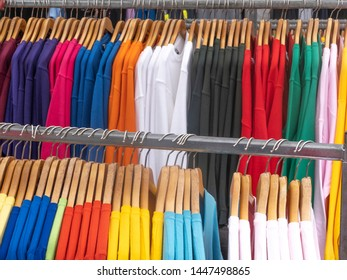 Colorful pullovers on a street market shop