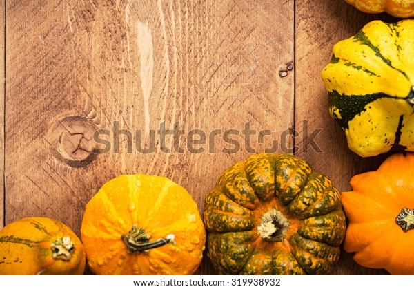 Colorful Pumpkins on wooden background - Halloween, Thanksgiving