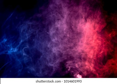 Colorful  purple and blue smoke clouds on dark background