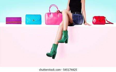 Colorful purses and bags with a woman sitting on pretty pink wall. Fashion and Shopping image.