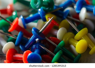 Colorful pushpins on a white board. School or business concept