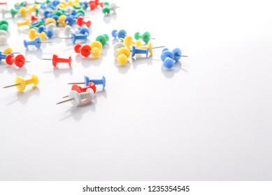 Colorful pushpins on white. Colored pushpins. Office accessories.