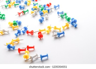 Colorful pushpins on white. Colored pushpins. Office accessories. Office supplies on white.