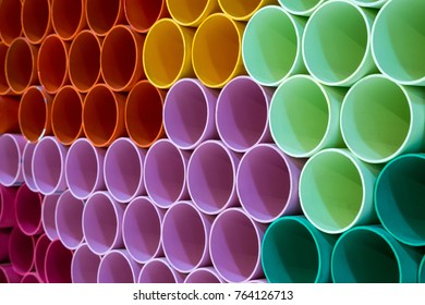 Colorful PVC pipes for the background.