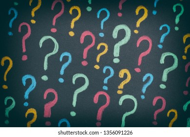 Colorful question marks on a black background. Concept image. Close up.