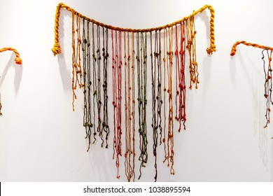 Colorful Quipu (abacus inca) caught on a wall