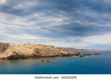colorful rain clouds  on the sea near the island