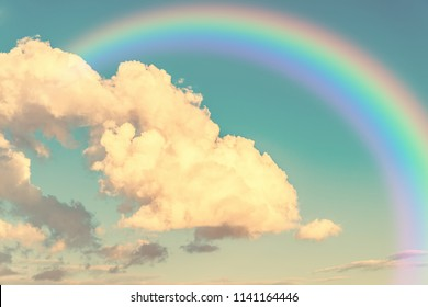Colorful rainbow in clouds - beauty in nature concept.
