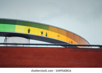 The colorful rainbow color glass walk way of the famous danish art museum with modern architecture. ARoS Aarhus Kunstmuseum, Aarhus, Denmark in Europe - 10.04.2019